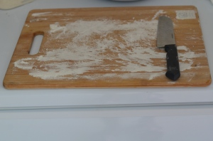 cutting board with flour sprinkled over
